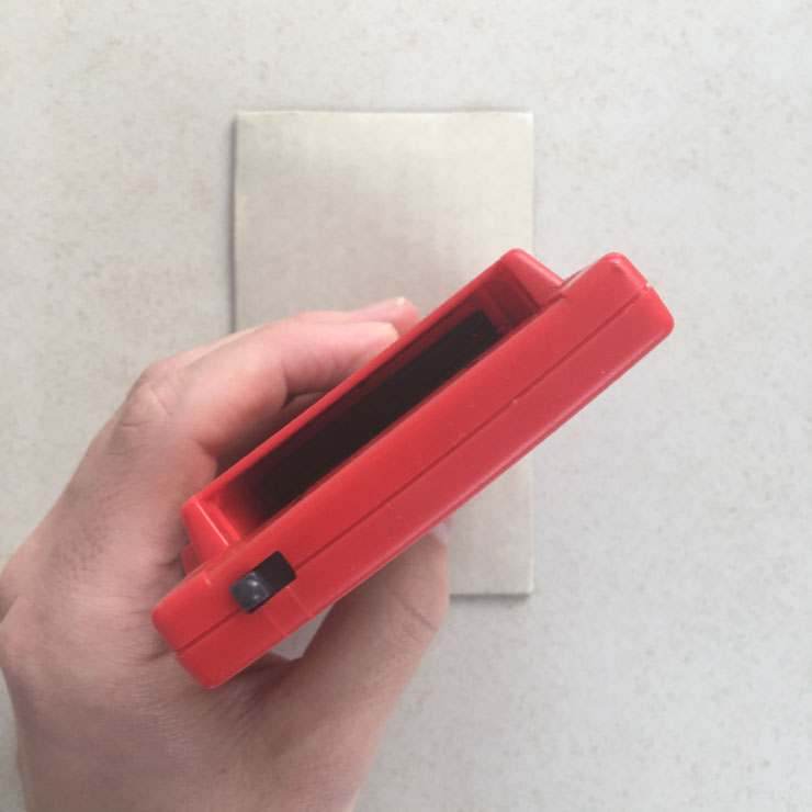GameBoy Pocket device (red) top cartridge slot
